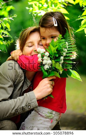Mother and daughter in park. - stock photo