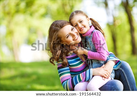 Mother and daughter in park. Mothers Day. - stock photo