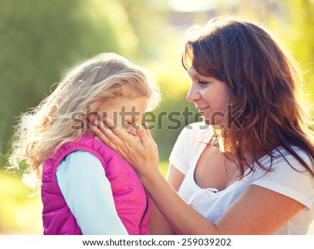 Mother and daughter in summer day