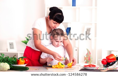 mother and daughter in the kitchen cooking