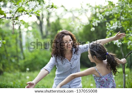 mother and daughter in the spring garden