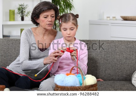 Mother and daughter knitting - stock photo