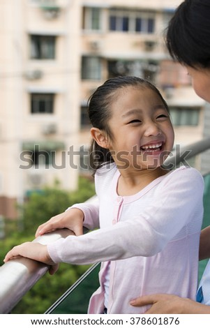 Mother and daughter laughing - stock photo