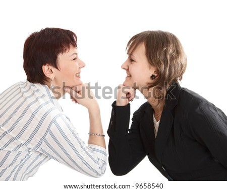 Mother and  daughter look against each other - stock photo