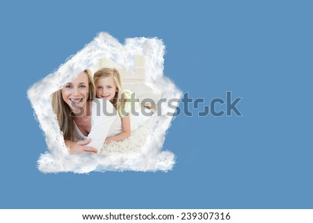 Mother and daughter lying on the floor against blue background with vignette - stock photo