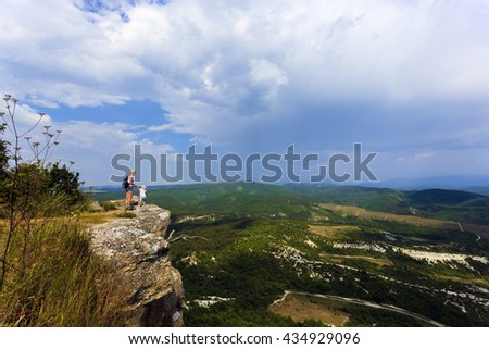 Mother and daughter on the edge - stock photo