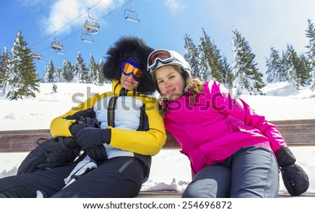 Mother and daughter on the ski vacation - stock photo