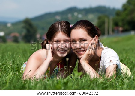 Mother and daughter outdoors - stock photo