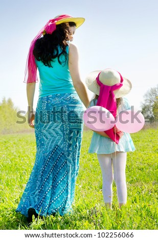 Mother and daughter outdoors in spring - stock photo