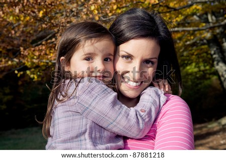 Mother and daughter outdoors on a autumn day - stock photo