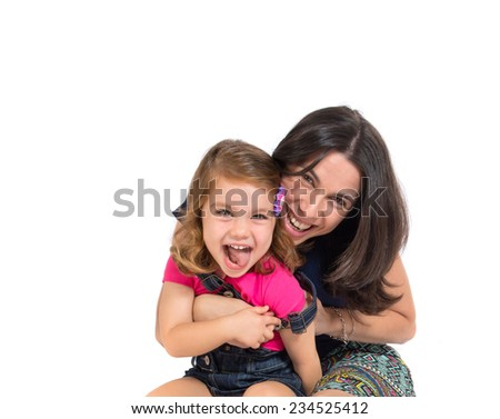 Mother and daughter over white background