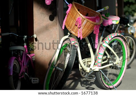 Mother and Daughter Pink Cruiser Bikes - stock photo