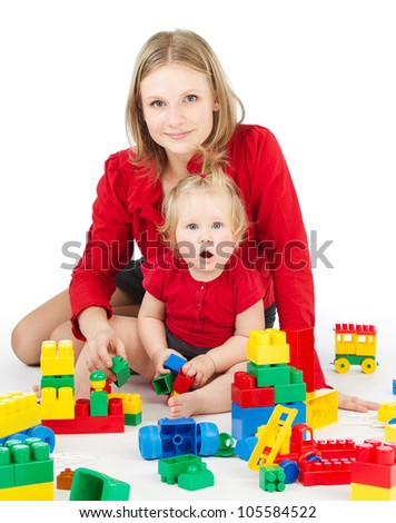 Mother and daughter playing together  blocks over white - stock photo