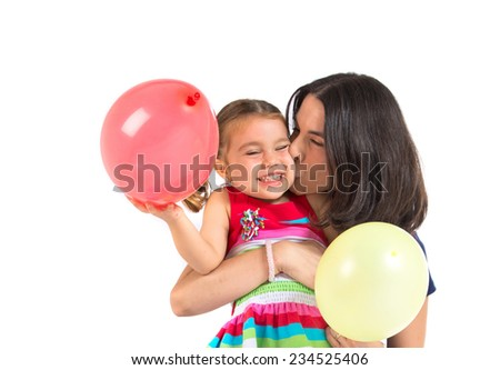 Mother and daughter playing with balloons