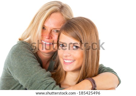 Mother and daughter posing happily, studio shot isolated on white