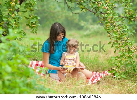 Brother sister on picnic sitting on stock photo 497871361 for Mother daughter vacation destinations
