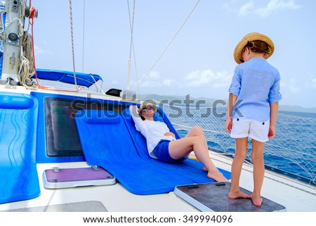 Mother and daughter relaxing on a luxury yacht - stock photo