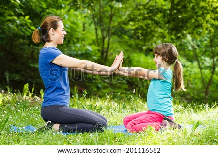 Mother and daughter resting in nature after exercise,Resting after exercise - stock photo