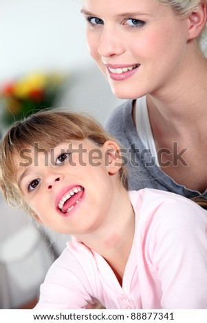 Mother and daughter sharing a moment of tenderness - stock photo
