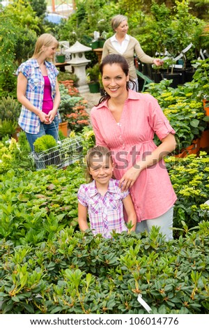 Mother and daughter shopping flowers at garden center shop