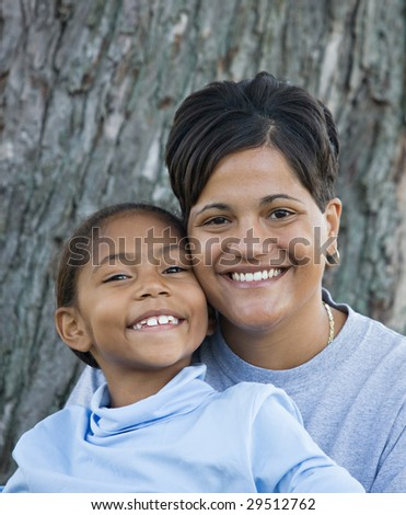 Mother and Daughter Sitting Together - stock photo