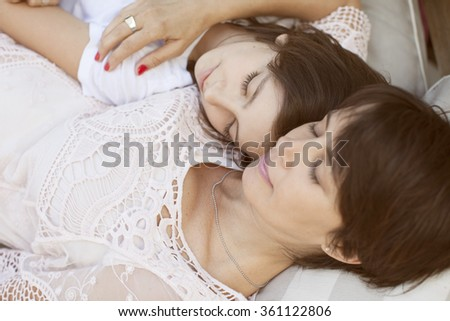 Mother and daughter sleeping together