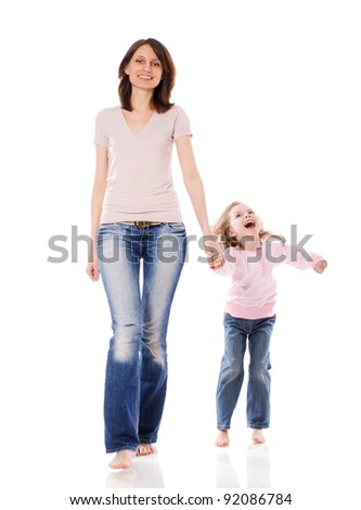 Mother and daughter smiling walking together isolated - stock photo