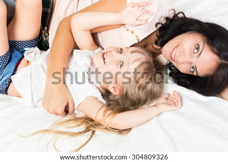 Mother and daughter spending time together at home