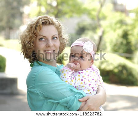 Mother and daughter sun summer day in the park - stock photo