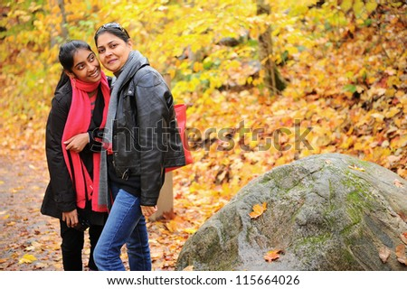 Mother and daughter talking to each other in outdoors - stock photo