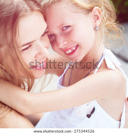 Mother and Daughter Teenager. Happy Hugging. Family, child and happiness concept Toned image - stock photo