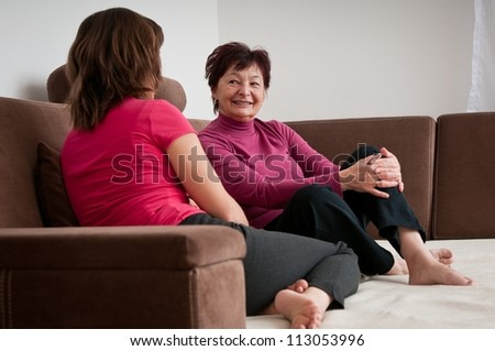 Mother and daughter together at home - stock photo