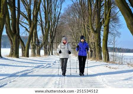 Mother and daughter train nordic walking - stock photo
