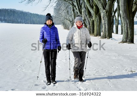 Mother and daughter train nordic walking