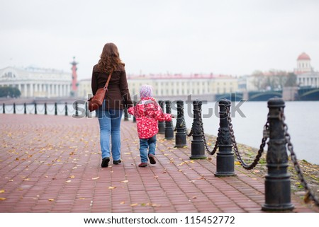 Mother and daughter walking in the center of Saint-Petersburg, Russia - stock photo