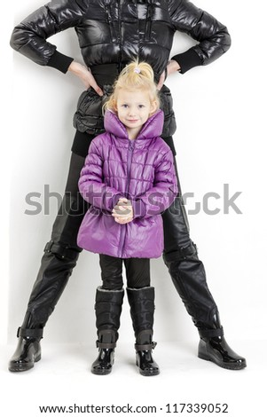 mother and daughter wearing jackets and black boots