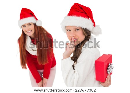 Mother and daughter with christmas gift on white background - stock photo