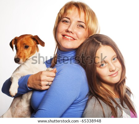 mother and daughter with Jack Russell Terrier. - stock photo