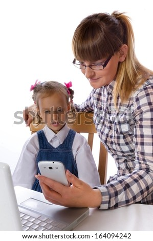 mother and daughter with mobile phone - stock photo