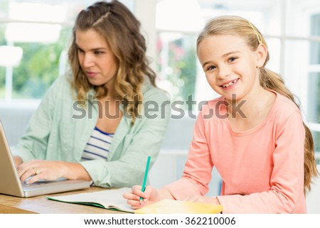 Mother and daughter working on the laptop