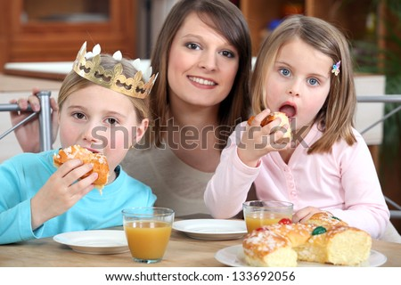 Mother and daughters eating cake