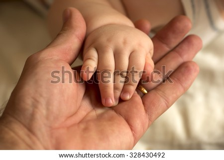 Mother and girl hands
