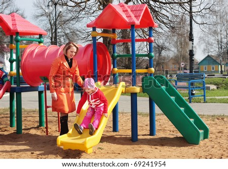 mother and girl on playground