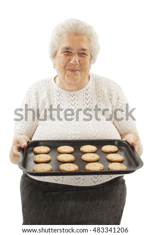 Mother and grand-mother welcoming her family with a smile and freshly baked home made chocolate cookies. Isolated on white background