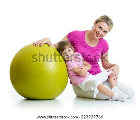 mother and her baby daughter fun with gymnastic ball