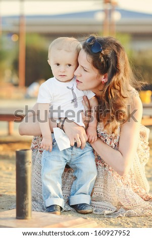 mother and her baby son outdoors - stock photo