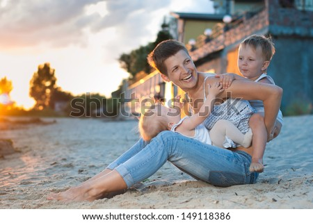 Mother and her children having fun - stock photo