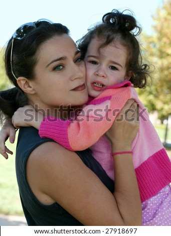 Mother and her crying daughter - stock photo