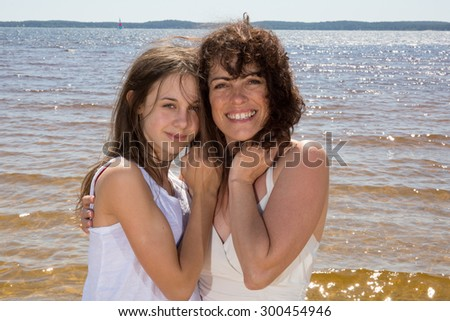 Mother and her daughter have fun together - stock photo