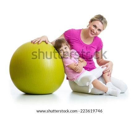 mother and her daughter kid having fun with gymnastic ball